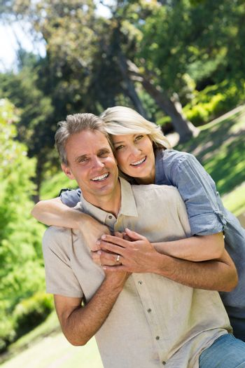 Couple with arm around in park