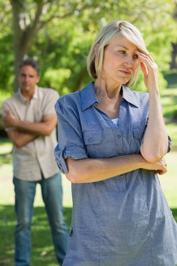 Upset couple in park
