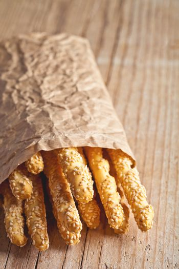 bread sticks grissini with sesame seeds in craft pack
