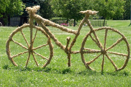 bike sculpture of straw on the lawn