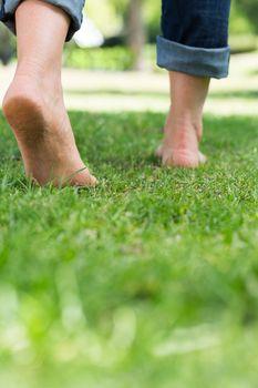 Woman walking on grassy land