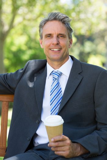 Businessman with disposable coffee cup