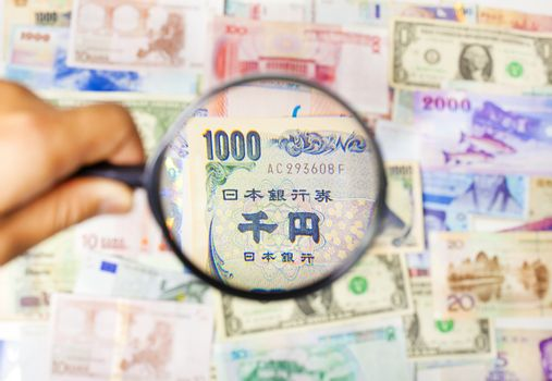 using a magnifier to search the method of Asian Market