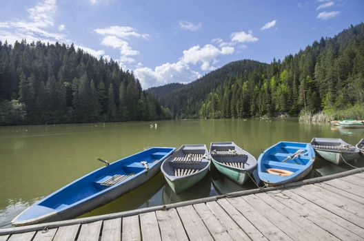 Boat docks on a beautiful lake in forest (Red Lake in Romania)