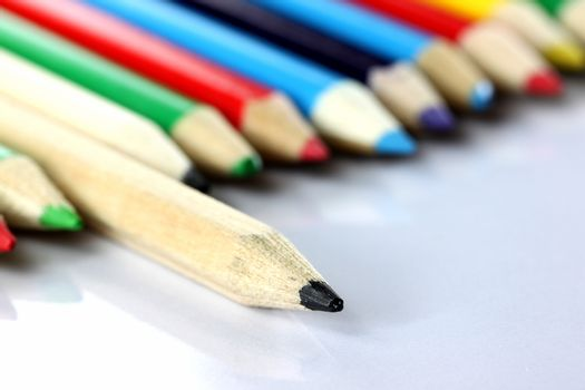 Several colored of crayon is arranged on white background.
