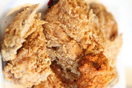 Fried chicken on a dish in a restaurant.