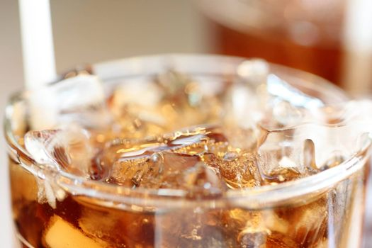 Ice cola drinks in glass for the beverage background.