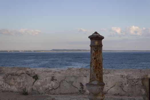 Old fountain  in front of the beach La Puritate in the old town of Gallipoli (Le)) in the southern of Italy