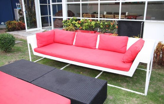 Red sofa in a restaurant for interior.
