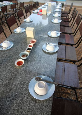 Dining table with arrangement dining accessories in restaurant.