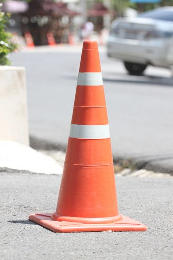 Traffic cones placed on the road.