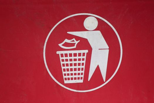 Symbol of waste disposal in to a bin.