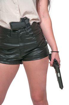 Beautiful woman with a loaded handgun pistol