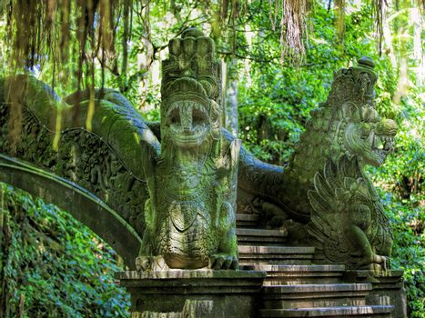 Dragon sculptures in the monkey forest, Bali, Indonesia