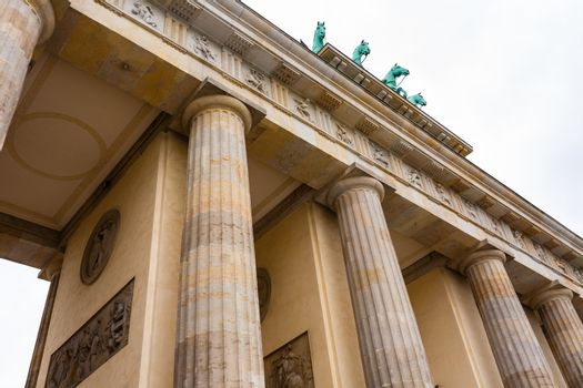 closeup view of brandenburg gate with columns and  horses in Berlin , Germany