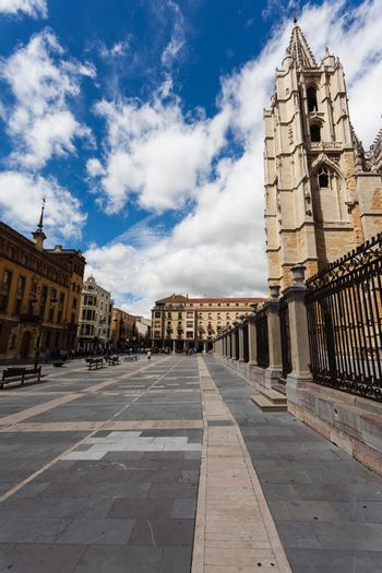 Cityscape of Leon with gotich cathedral on the right and square pedrestrian view in Spain