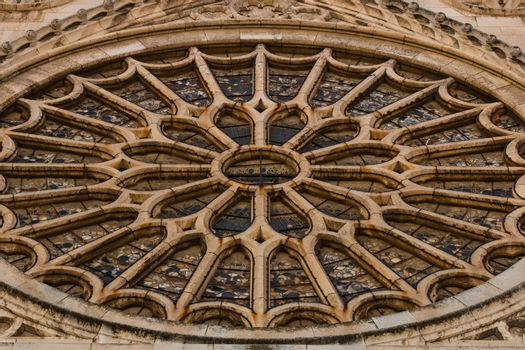 Closeup view of the entrance rose window with its stained glasses in the gothic cathedral of Leon, Spain