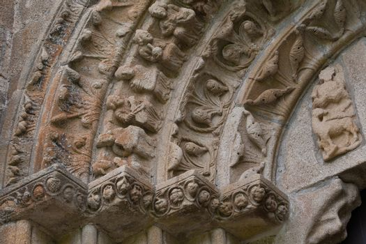 closeup view of archivolts,voussoir and capitals in the romanesque monatery of Carboeiro in the province of Pontevedra Spain