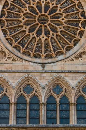 Lancet arch shaped windows and main rose window with ist stained glasses in the gothic cathedral of Leon, Spain