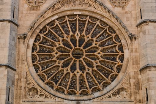 View of the entrance rose window with its stained glasses in the gothic cathedral of Leon, Spain