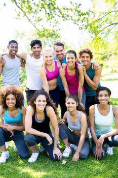 Friends in sportswear at park