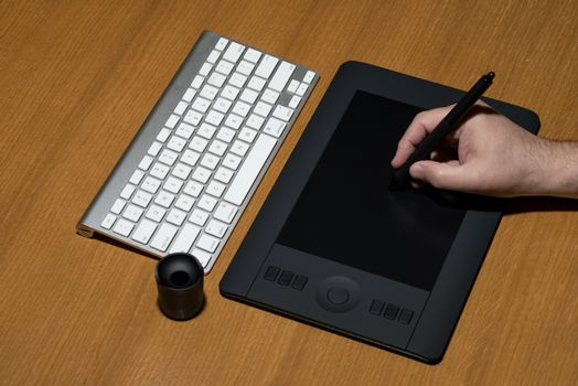 Closeup Of One Hand Drawing On A Computer Graphics Tablet