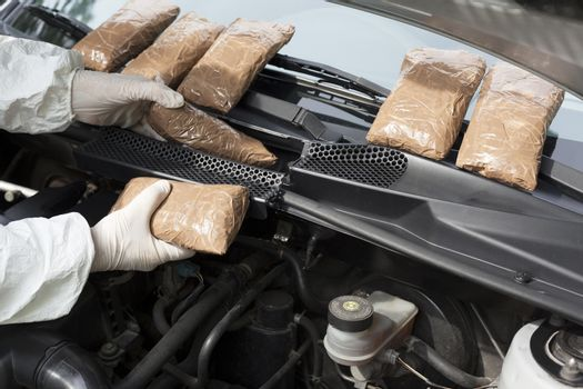 Drug smuggled in a car's engine compartment