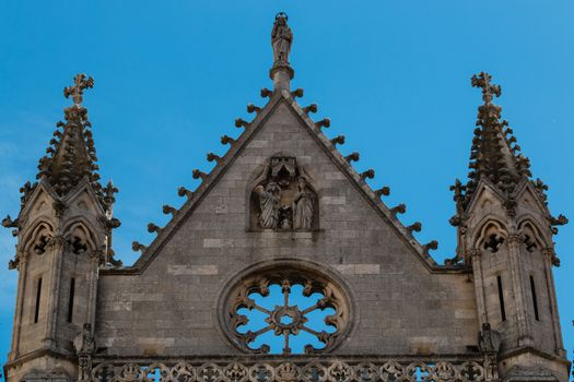 Pinnacles finely decorated in the facade of the gothic catedral of Leon in Spain