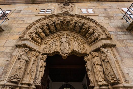 Carved romanesque door entrance to the san Xerome building in Santiago de Compostela, Spain
