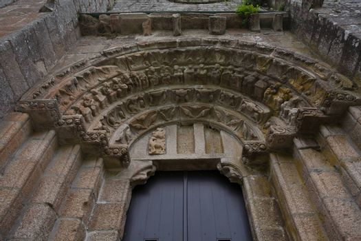 Lateral door with its archivolts and voussoir in the romanesque monatery of Carboeiro in the province of Pontevedra Spain