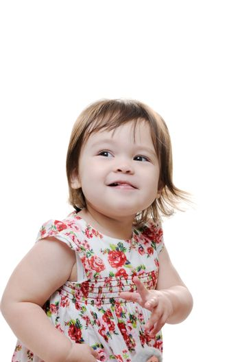 Cheerful young infant girl with tongue out