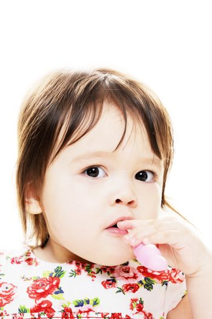 Closeup portrait of little girl brushing her teeth