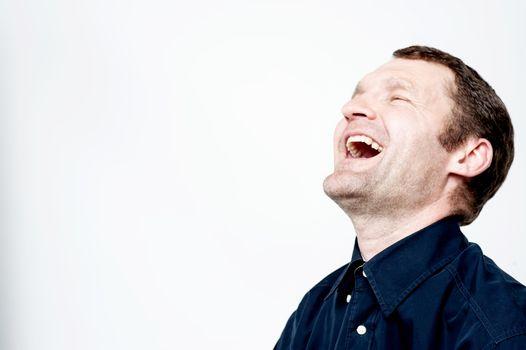 Portrait of hard laughing man