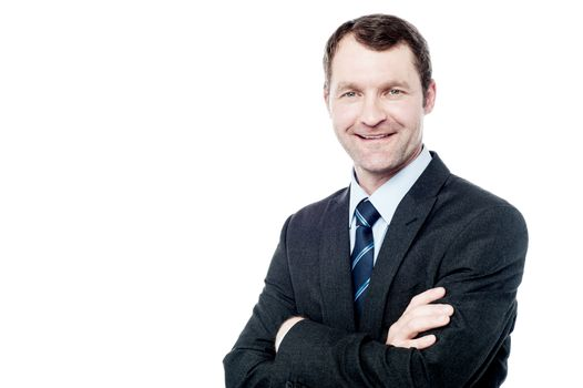 Cheerful businessman with arms folded
