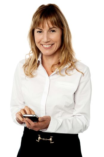 Business executive using her mobile