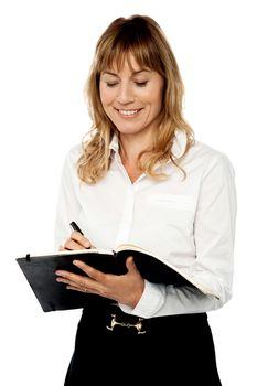 Female secretary writing notes