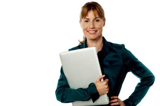 Smiling secretary holding laptop