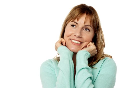 Happy female with hands on chin