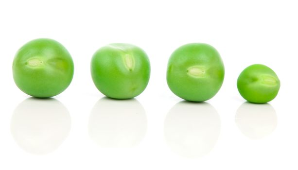 Green peas isolated on white, clipping path included