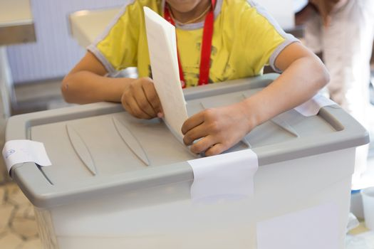 Boy voting on democratic election.