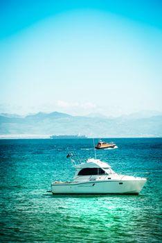 Yachts on azure sea water