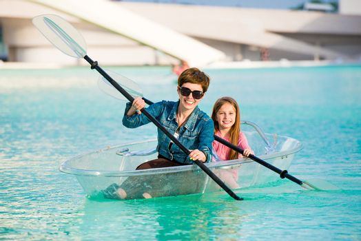little girl with mother kayak