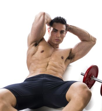 Fit muscular man doing exercises