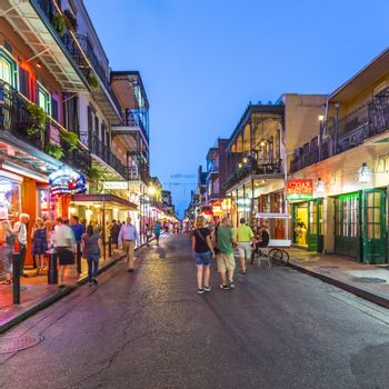 NEW ORLEANS, LOUISIANA - JULY 14, 2013: Neon lights in the French Quarter, New Orleans, USA. Tourism provides a much needed source of revenue after the 2005 devastation of Hurricane Katrina.