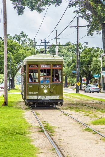 NEW ORLEANS - JULY 16, 2013: famous old Street car St. Charles line in New Orleans, USA. It is the oldest continually operating street car line in the world.
