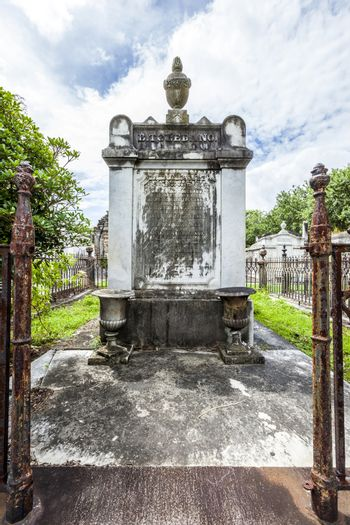 NEW ORLEANS, USA - JULY 16, 2013: Lafayette cemetery with historic Grave Stones in New Orleans, USA. Built in what was once the City of Lafayette, the cemetery was officially established in 1833.