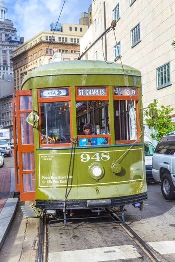 NEW ORLEANS, USA - JULY 17, 2013:   Streetcar Line St. Charles in new Orleans, USA. Newly revamped after Hurricane Katrina in 2005, the New Orleans Streetcar line began electric operation in 1893.