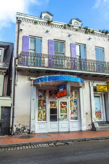 NEW ORLEANS, LOUISIANA USA - JULY 17, 2013: sex shops in old historic building in the French Quarter in New Orleans, USA. Tourism provides a large source of revenue after the 2005 devastation of Hurricane Katrina.