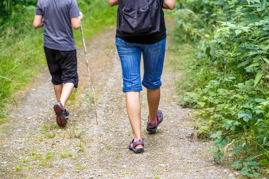 Woman walking with son cross country