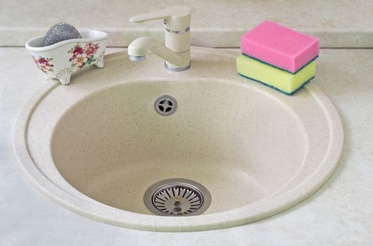Sink for ware from metal ceramics and a sponge for washing.